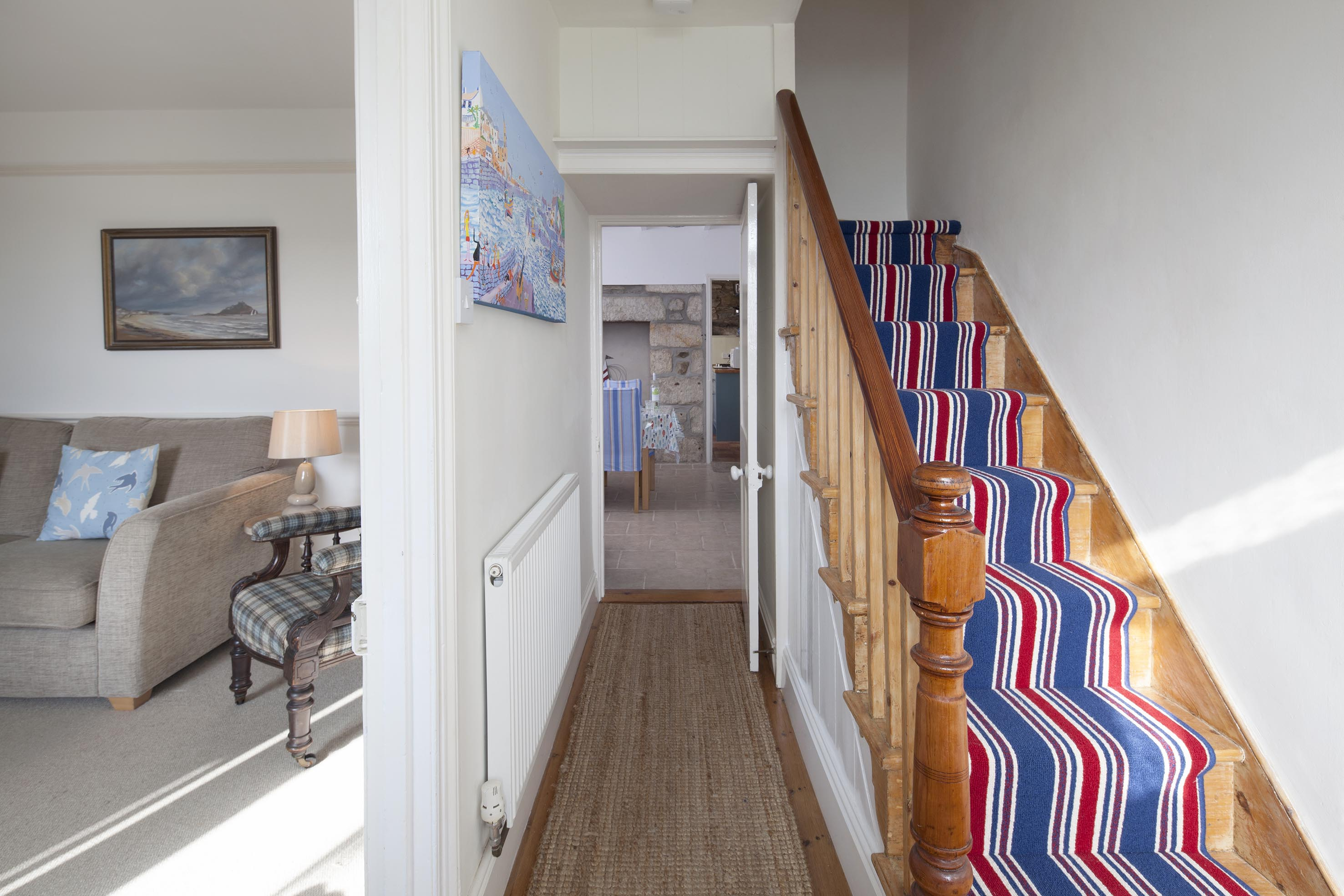 Shot of the corridor, stairway and living area on this holiday home