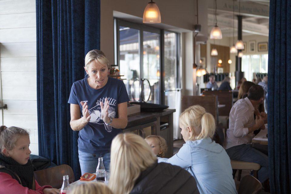 Waitress taking orders at RockFish