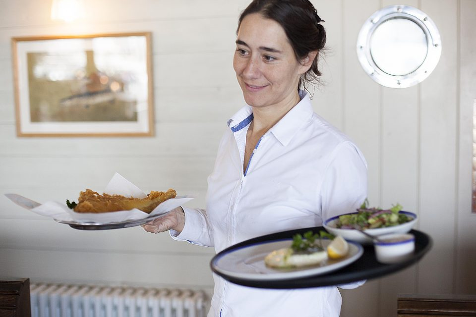 Waitress serving lunch at RockFish