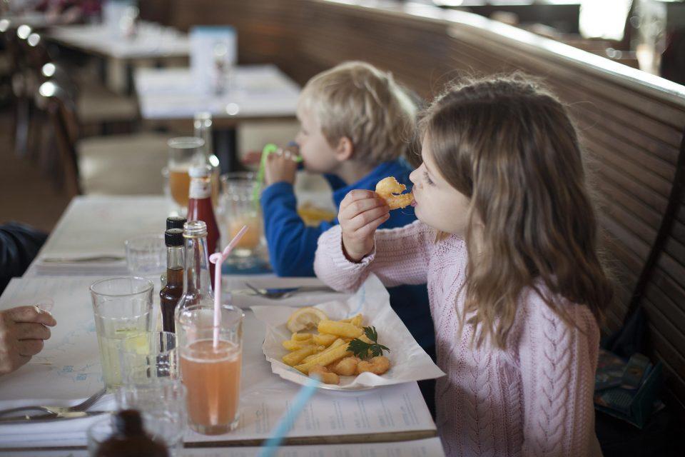 Children enjoying lunch and RockFish