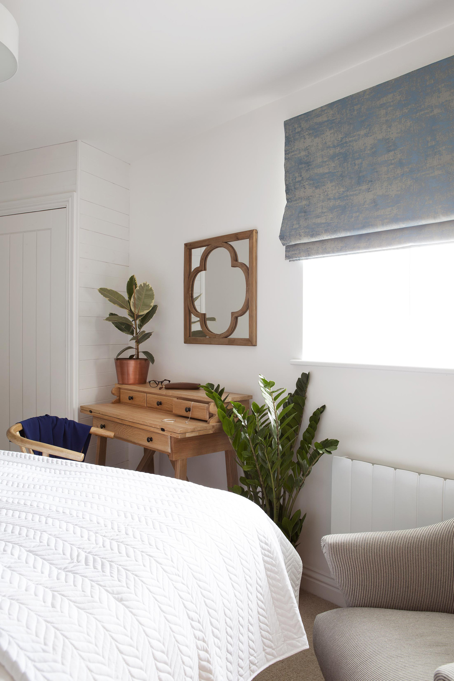 Cornwall Architecture Photographers: Interior shot of a bedroom with coffee table and plant life.