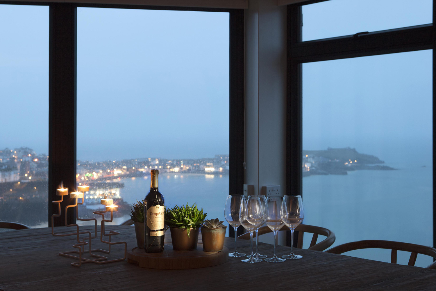 Architecture photographers in Cornwall: Interior shot of a dining table looking out over the ocean.